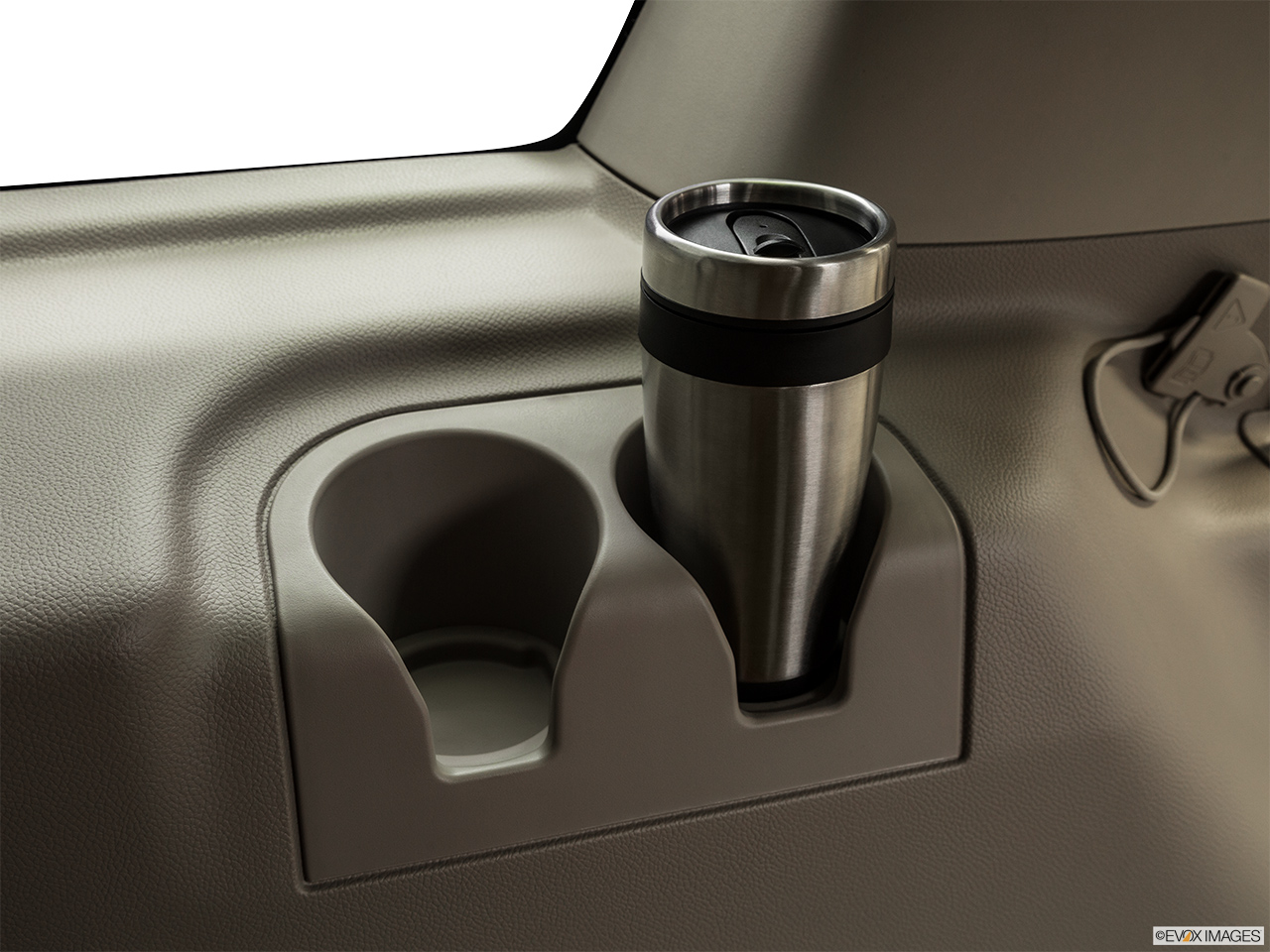 2015 Lincoln Navigator Base Third Row side cup holder with coffee prop.