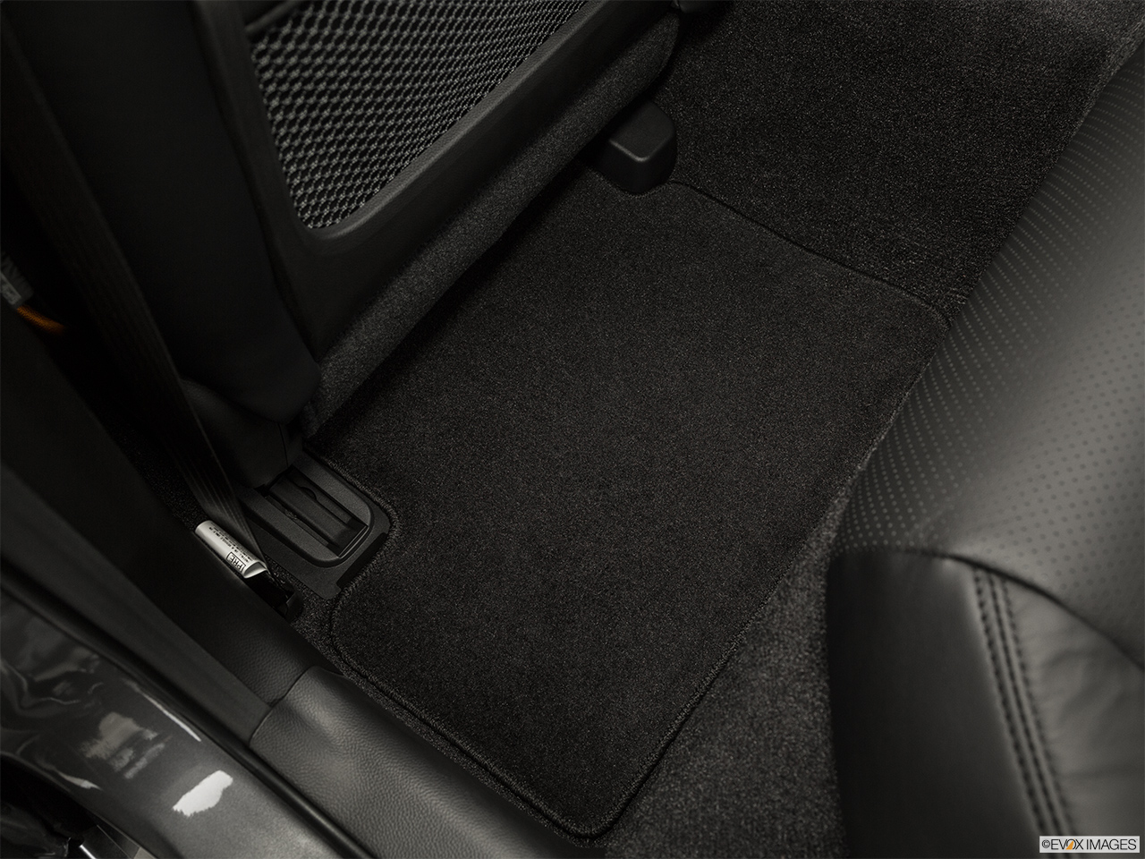 2015 Infiniti Q40 Base Rear driver's side floor mat. Mid-seat level from outside looking in.